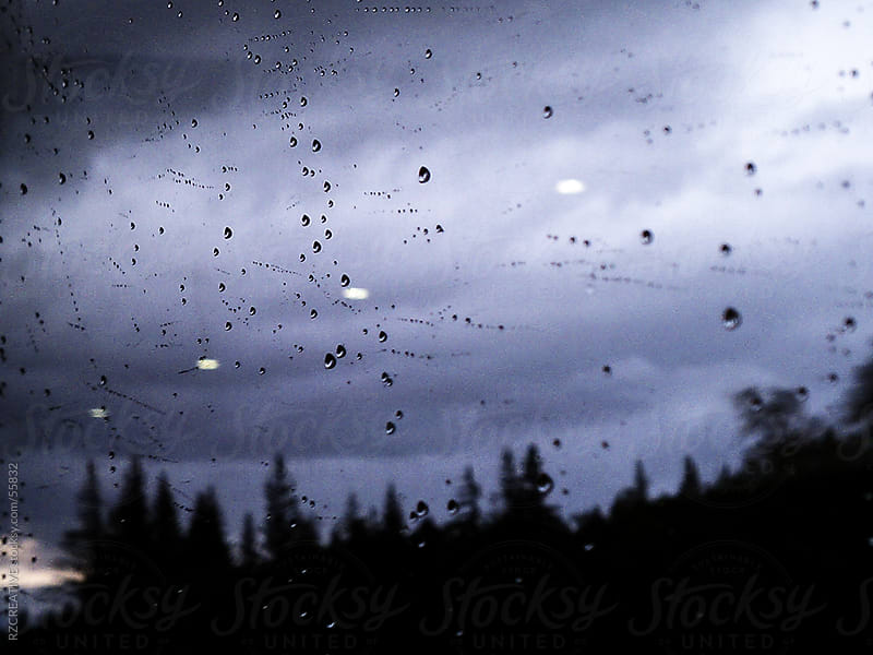 Rain drops accumulate on a window on the Alaska Railroad. Captured with an iPhone. by RZ CREATIVE for Stocksy United