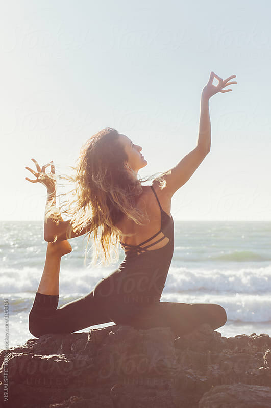 Yoga: Woman in Pigeon Pose by VISUALSPECTRUM for Stocksy United