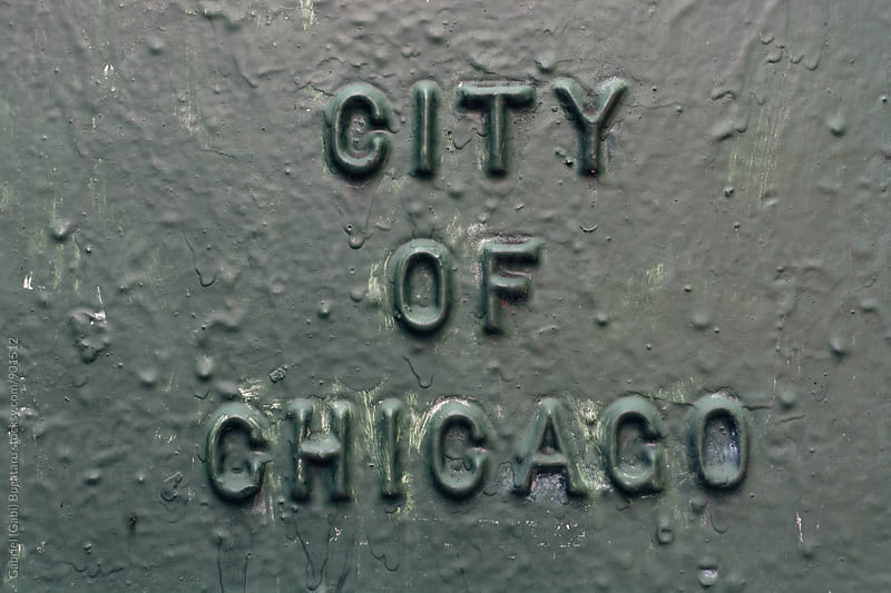 City of Chicago written on a metallic cover by Gabriel (Gabi) Bucataru for Stocksy United
