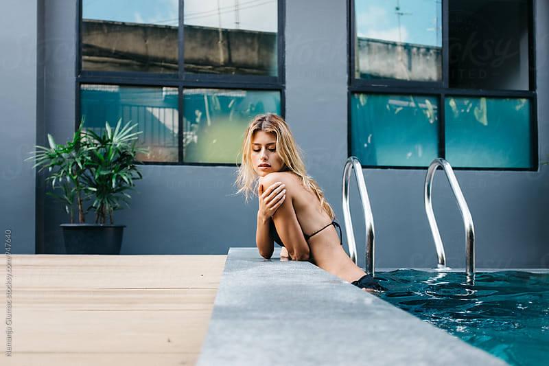 Beautiful Blond Woman Posing While Standing in a Pool by Nemanja Glumac for Stocksy United