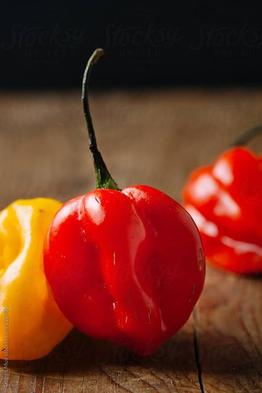 Closeup of scotch bonnet chili peppers. by Darren Muir for Stocksy United