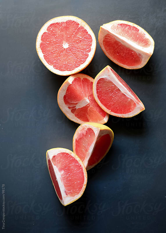 Sliced Grapefruits by Tina Crespo for Stocksy United