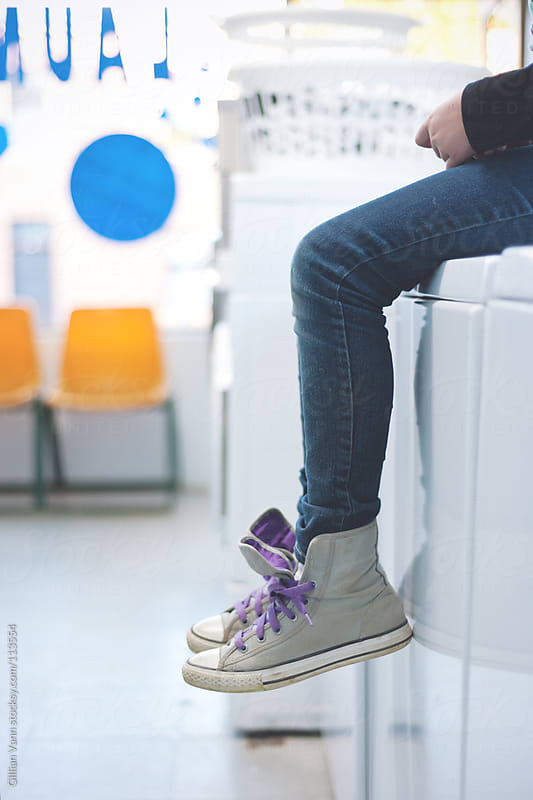 waiting at the laundromat by Gillian Vann for Stocksy United