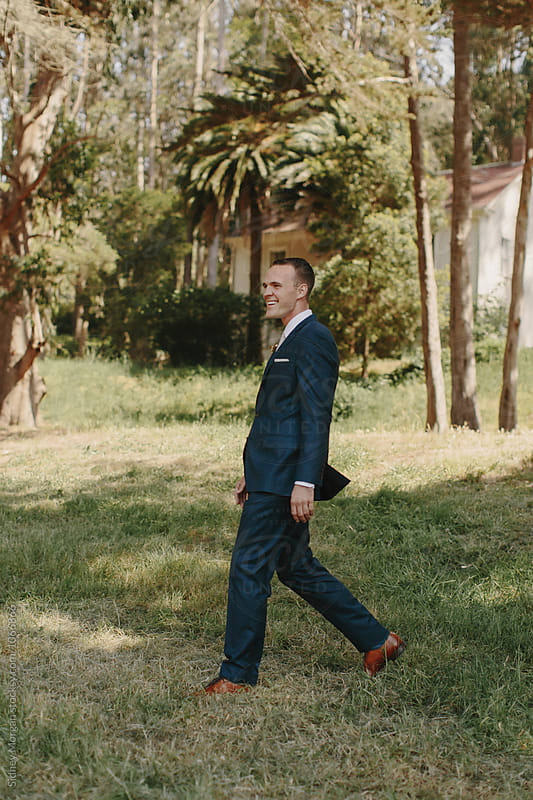 Groom Walking to Ceremony by Sidney Morgan for Stocksy United