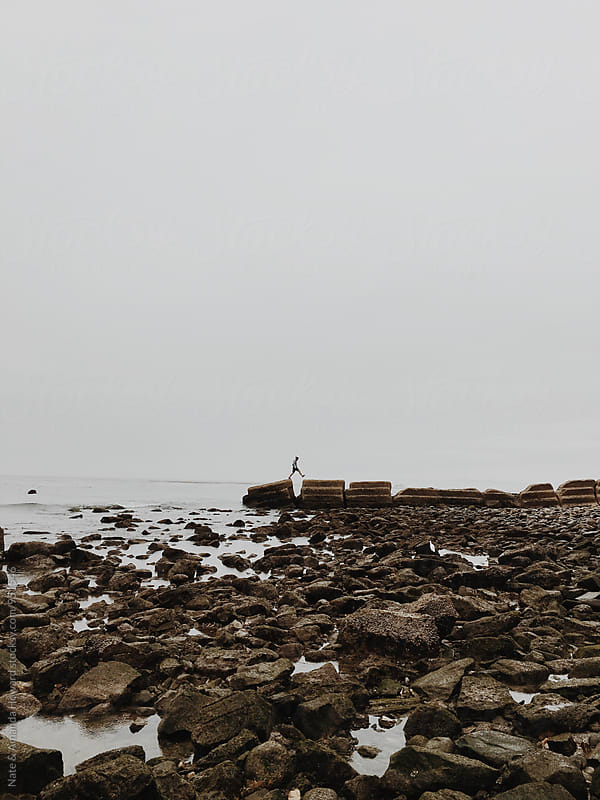 rocky shoreline by Nate & Amanda Howard for Stocksy United