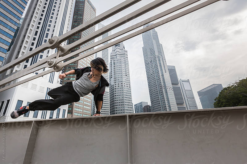 Parkour on a bridge by Felix Hug for Stocksy United