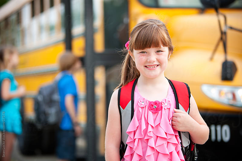 School Bus: Smart Girl Ready for School by Sean Locke for Stocksy United
