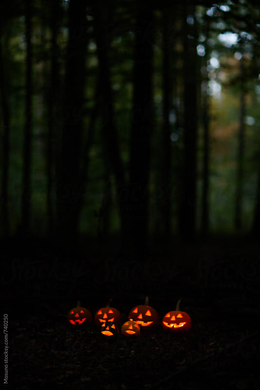 Scary Halloween Pumpkins in the Forest at Dusk by Mosuno for Stocksy United