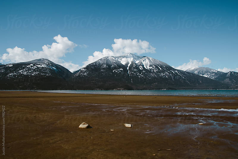 Long sandy beach on Kootenay Lake, Canada. by Justin Mullet for Stocksy United
