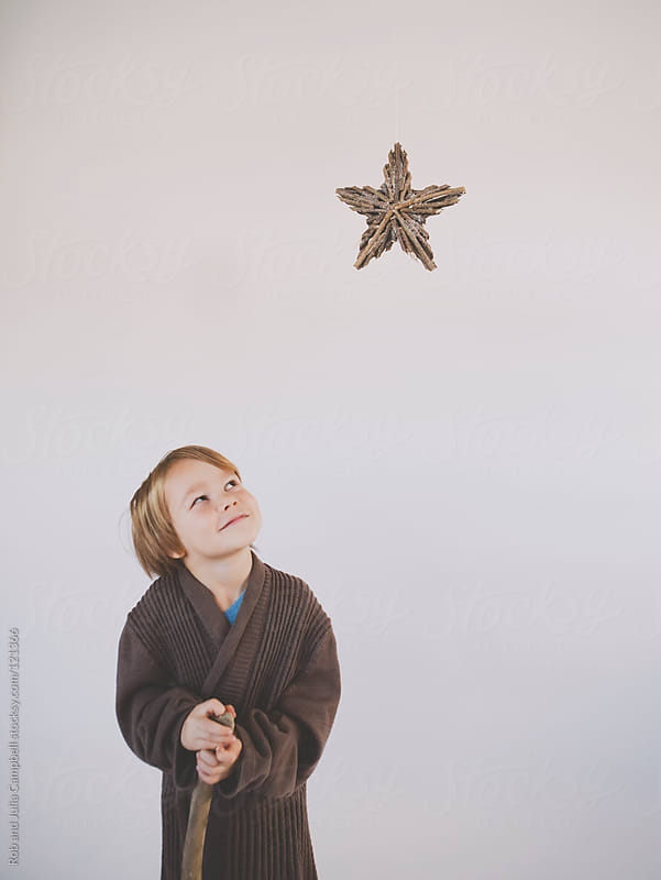 Shepherd looks up at star of bethlehem by Rob and Julia Campbell for Stocksy United