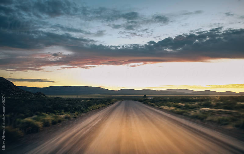 Sunset whilst travelling on a dirt road through the karoo by Micky Wiswedel for Stocksy United