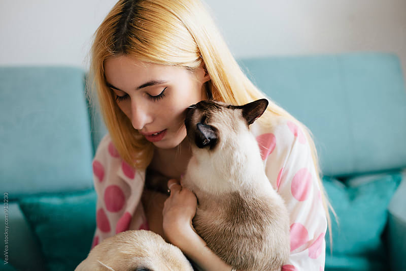 Portrait of a beautiful woman and her cat indoor by VeaVea for Stocksy United