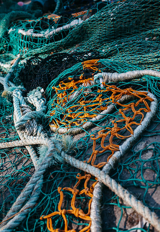 Fishing nets in the harbour at Ilfracombe. Devon, UK. by Liam Grant for Stocksy United