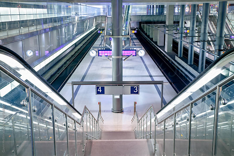 Europe, Germany, Berlin, modern train station  - stairway and escalator leading to the platform by Gavin Hellier for Stocksy United
