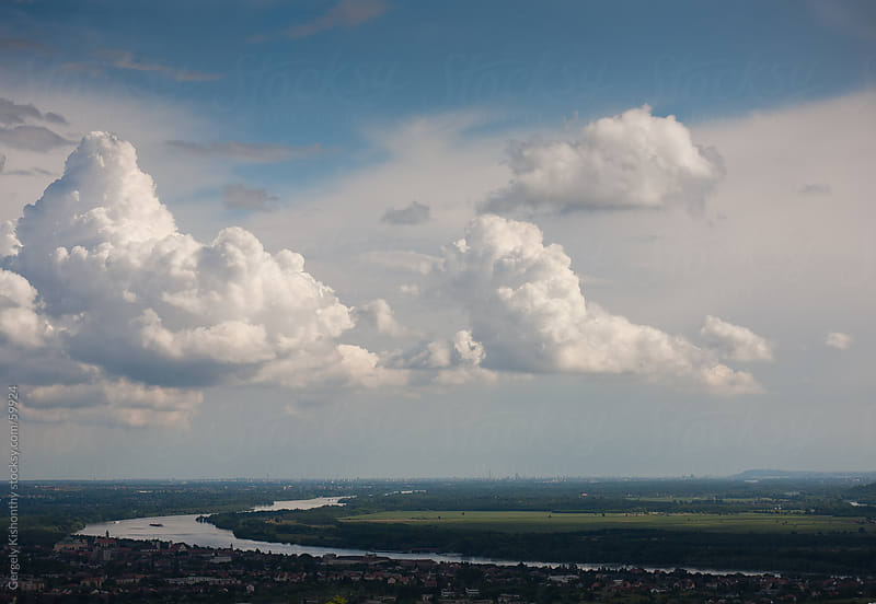 Stormy weather over the Danube bend. by Gergely Kishonthy for Stocksy United