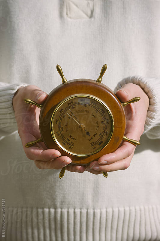 Holding a barometer by B & J for Stocksy United