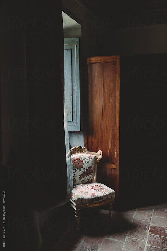 Old chair in the light of a window by michela ravasio for Stocksy United