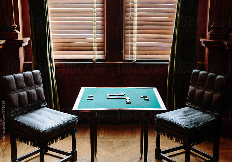 Dominoes strategy game on table near window by Matthew Spaulding for Stocksy United
