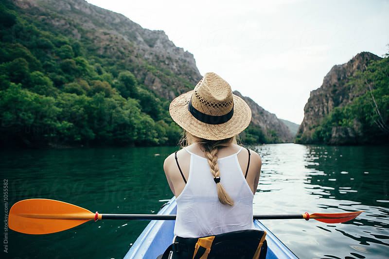 Woman kayaking and enjoing the view by Ani Dimi for Stocksy United
