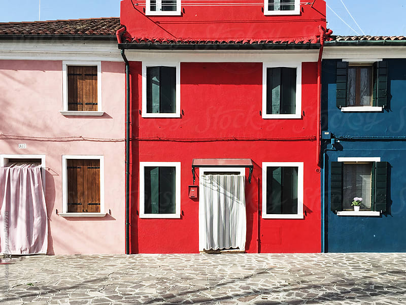Three colourful building exteriors in Burano, Venice by Kirstin Mckee for Stocksy United