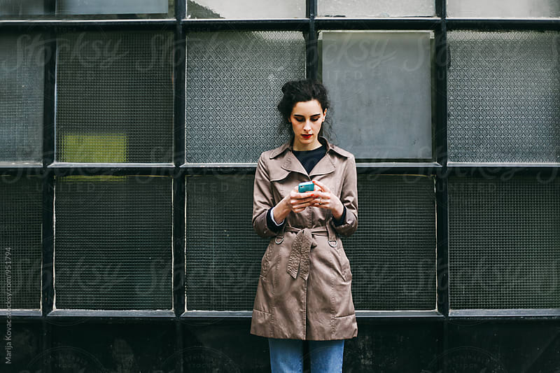 Woman browsing on her mobile phone by Marija Kovac for Stocksy United