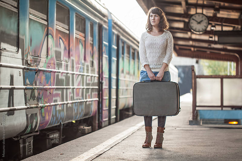 Female Traveler at the Train Station by Mosuno for Stocksy United