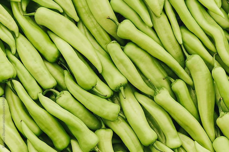 Fresh green peppers in the market by Borislav Zhuykov for Stocksy United