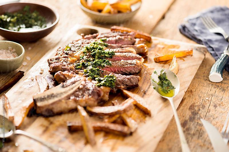 Steak Frites: Sliced Ribeye Steak with Chimichurri Sauce and Fries