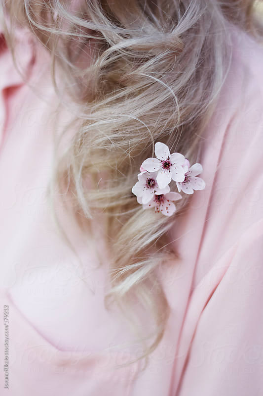 Flower in girl's hair by Jovana Rikalo for Stocksy United