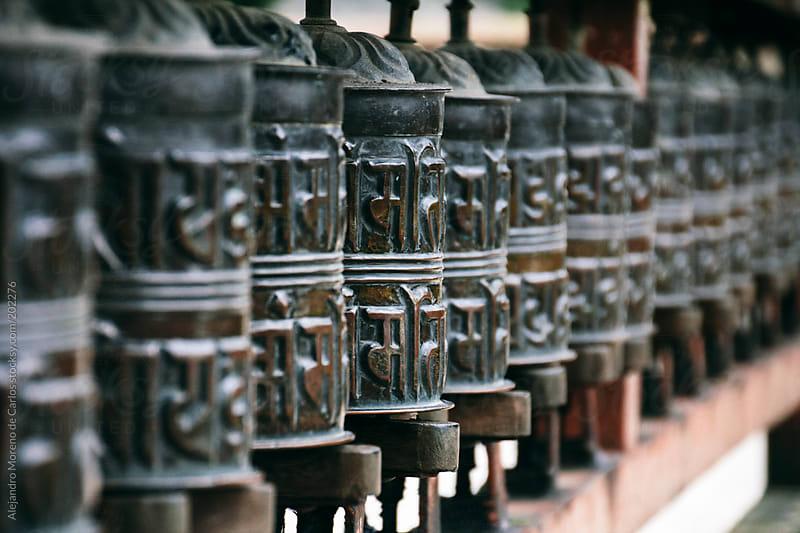Buddhist spinning prayer wheels by Alejandro Moreno de Carlos for Stocksy United