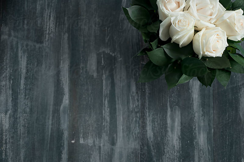 White roses on shabby wooden surface by Alita Ong for Stocksy United