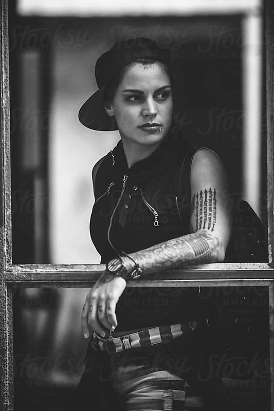 tattooed urban girls portrait , style, attitude by Igor Madjinca for Stocksy United