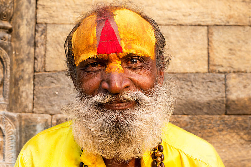 Portrait of a smiling Holy Man in Kathmandu by Bisual Studio for Stocksy United