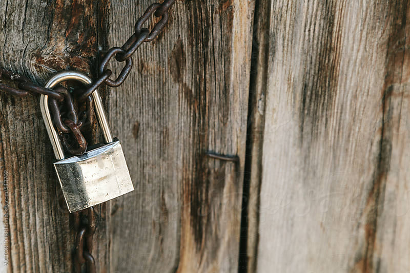 Old Padlock on a Wooden Door by VICTOR TORRES for Stocksy United