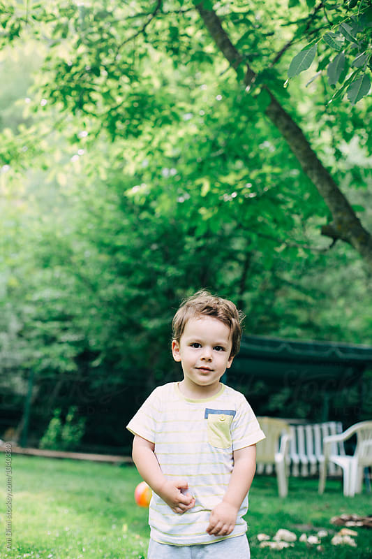 Little Boy in the yard by Ani Dimi for Stocksy United