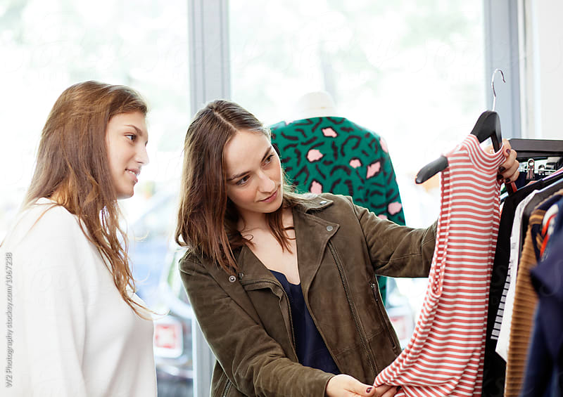 Friends shopping in a clothing boutique. by W2 Photography for Stocksy United