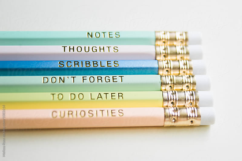 Colorful pencils printed with helpful messages. by Melissa Ross for Stocksy United