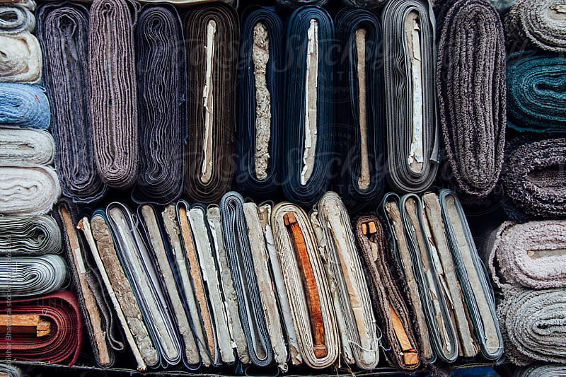 Rolls of textile on display on a wholesale market. by Shikhar Bhattarai for Stocksy United