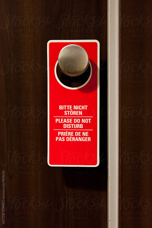 Do Not Disturb Label Hanging on Doorknob by Victor Torres for Stocksy United