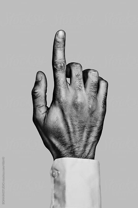 Businessman hand pointing. Black and white by BONNINSTUDIO for Stocksy United