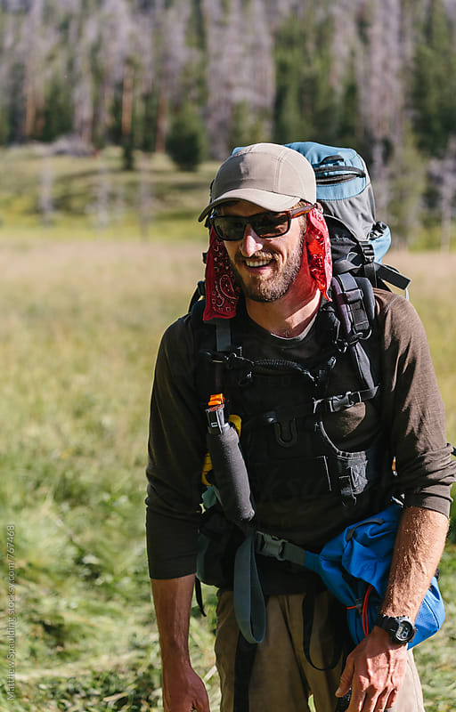 Happy man prepared for backpacking adventure by Matthew Spaulding for Stocksy United