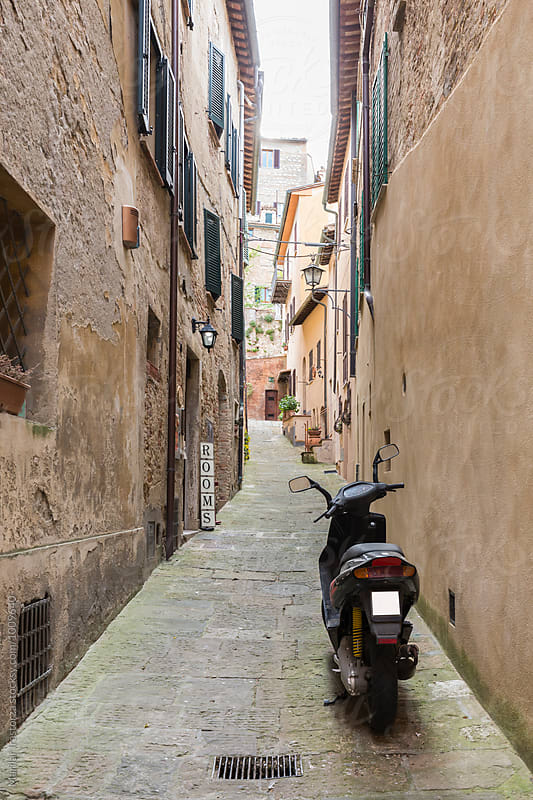 Motorcycle on a narrow italian street by Marilar Irastorza for Stocksy United