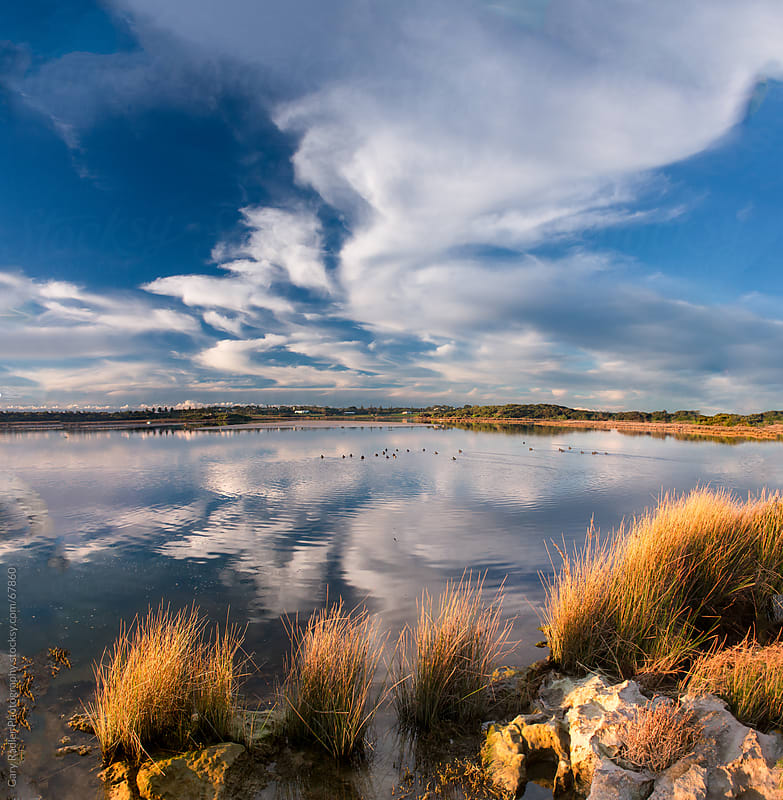 Clouds reflected at Glenelg River Mouth in Australia by Gary Radler Photography for Stocksy United
