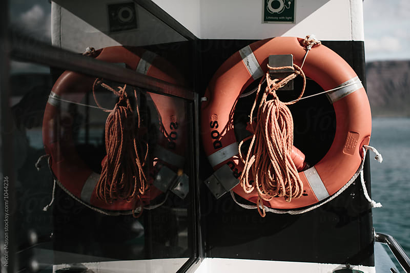 live saving device hanging up on ship by Nicole Mason for Stocksy United