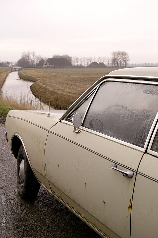 Vintage car on rural dutch road by Marcel for Stocksy United