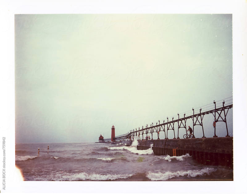 A Pier On A Cloudy Day Photographed On Expired Polaroid Peel Apart Film by ALICIA BOCK for Stocksy United