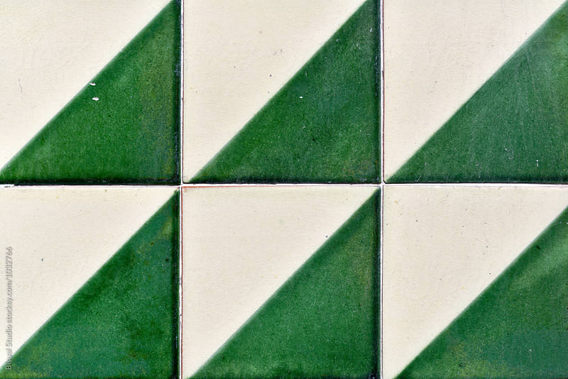 Vintage tiles on a wall by Bisual Studio for Stocksy United