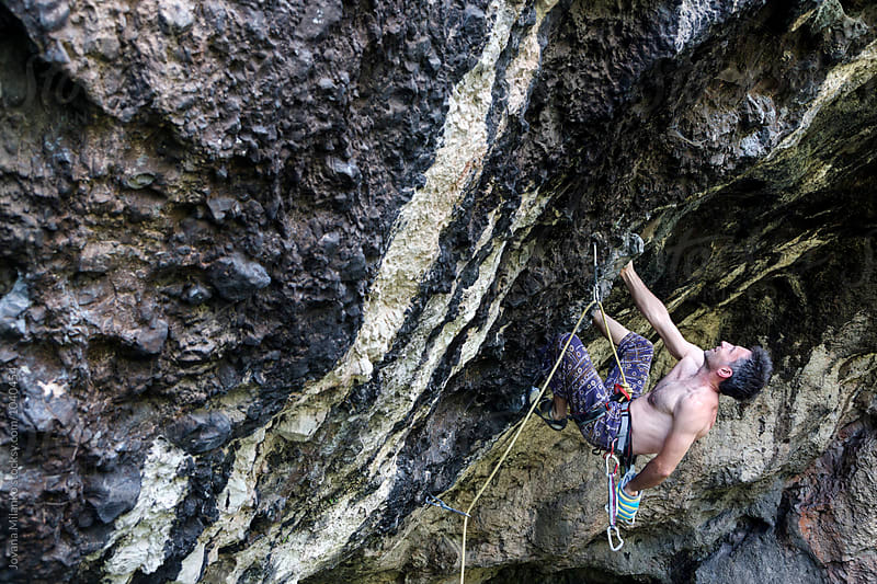 Free climber leading a route on a natural rock outdoor by Jovana Milanko for Stocksy United