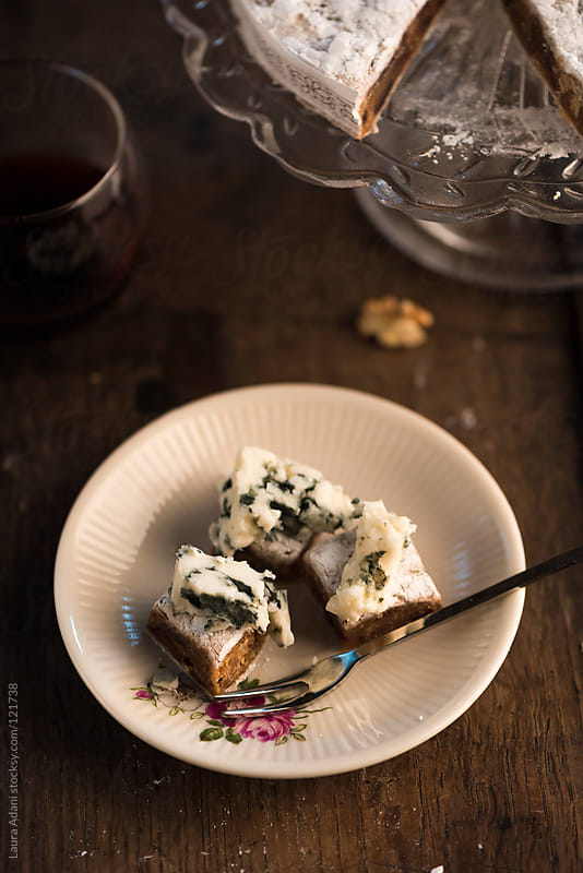 Panforte di Siena served with blue cheese by Laura Adani for Stocksy United