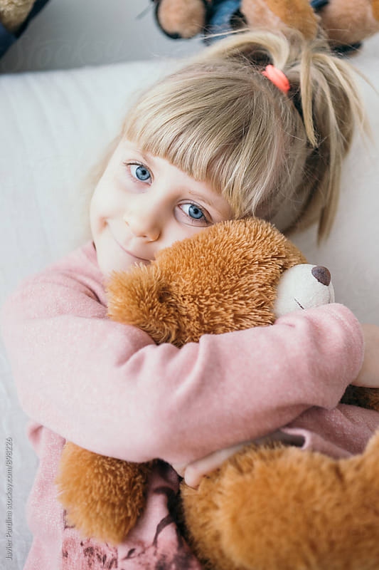 child playing with bear by Javier Pardina for Stocksy United